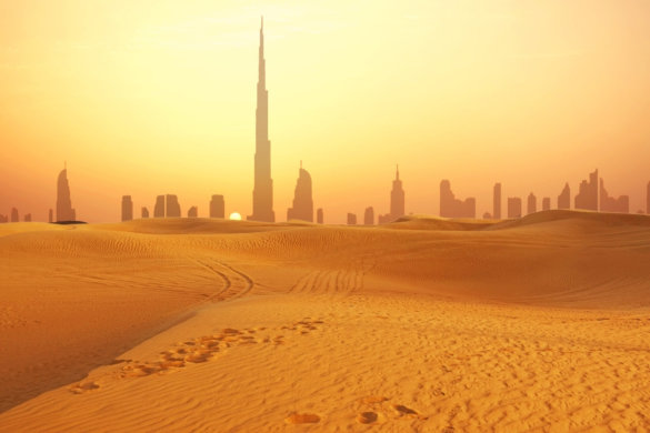 Burj Khalifa over sizzling sand dunes Dubai in Summer