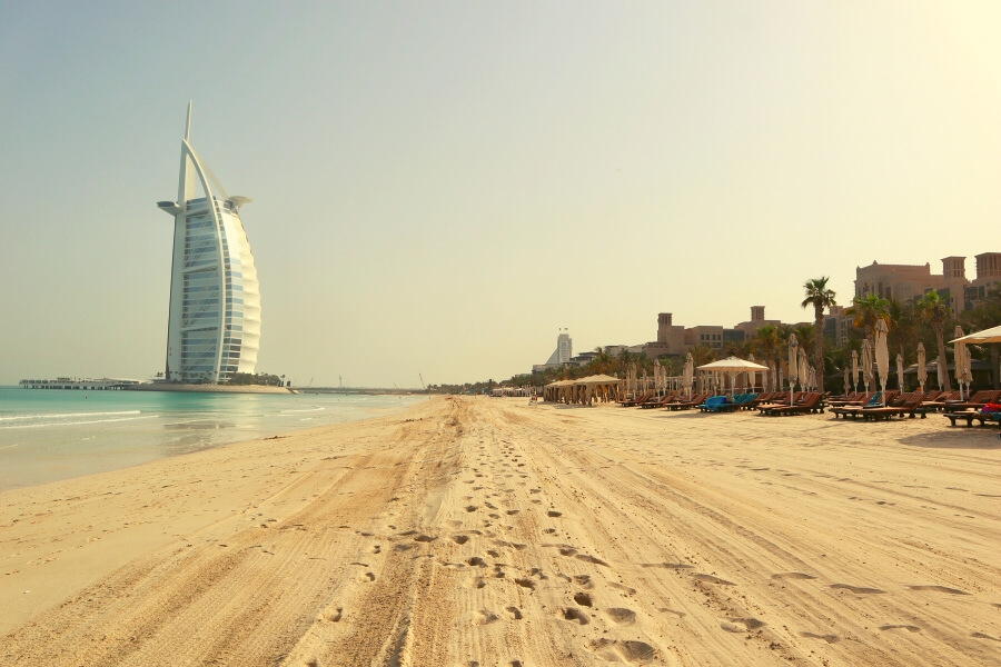 Burj Al Arab along the soft go9lden beach front in Dubai in may