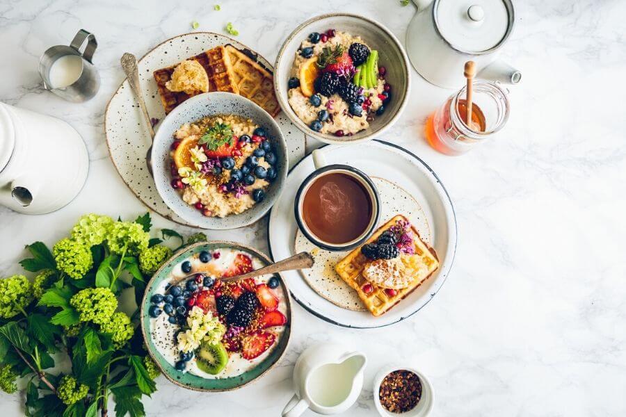 A breakfast table spread with food Dubai Breakfast